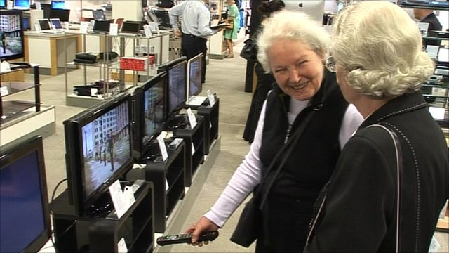 Elderly ladies loooking in TV store