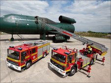 Two firefighting vehicles at Manchester Airport