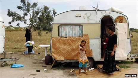 File photograph of a family in front of a caravan in an illegal Roma camp near Nantes, France