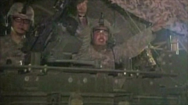 US forces celebrate as they leave Iraq through Kuwait