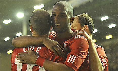 Ryan Babel (centre) celebrates his goal against Trabzonspor