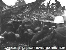 US servicemen dig through the rubble of the Snack Bar