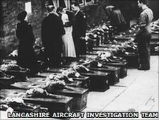 The rows of tiny coffins bear silent witness to the village's loss