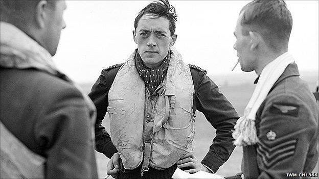 Squadron Leader B J E 'Sandy' Lane (centre), pictured here aged 23. He was killed in combat 2 years later.