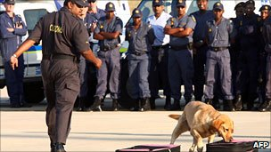 A dog sniffs for drugs at Durban's King Shaka International Airport in May in a training exercise (May 2010)
