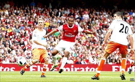 Theo Walcott scores his third goal and Arsenal's fourth against Blackpool