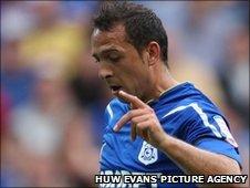 Cardiff striker Michael Chopra will undergo X-rays on his ankle injury