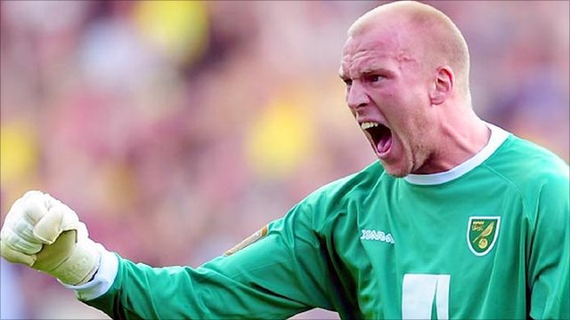 Norwich goalkeeper John Ruddy celebrates saving a penalty against Swansea
