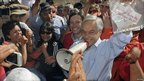 Chilean President Sebastian Pinera holds up a note from trapped miners in Copiapo, Chile, 23 August 2010, 22 August 2010