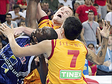 GB's Luol Deng gets quickly closed down by Macedonia's players