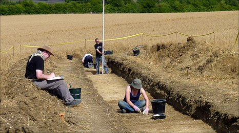 Archaeologists recording their finds in trench II