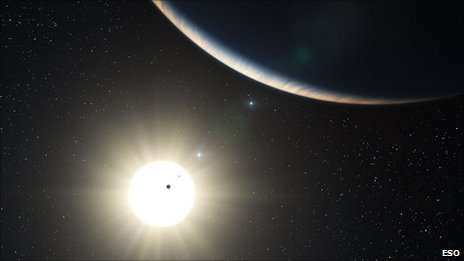 Artist's impression of the planetary system orbiting HD 10180 (Image: ESO)