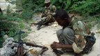 Fighters from the al-Shabab Islamist militia inspect their weapons