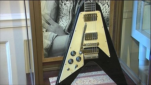 A prized Gibson Flying V is among the items on display