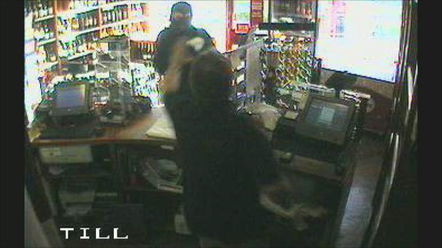CCTV still of Mike Komorowski confronting an armed robber