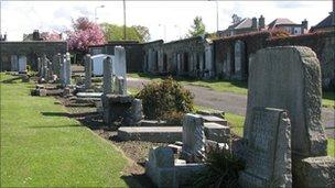 Fallen headstones  (Pic: Alan McKinney)