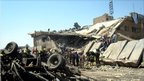 A collapsed building is seen at the site of a bombing in Baghdad, Iraq