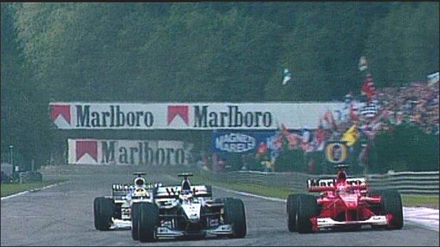 Mika Hakkinen passes Michael Schumacher