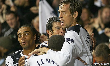 Tottenham striker Peter Crouch (right) is congratulated by team-mates after scoring in his side's win against Youngs Boys