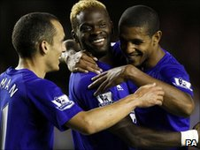 Louis Saha (centre) celebrates his goal