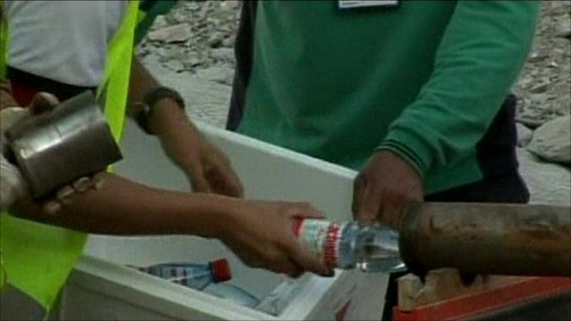 Rescue workers sending down food supplies