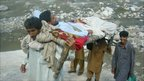 A sick person being carried on a stretcher. Photo: Omar Ahsan