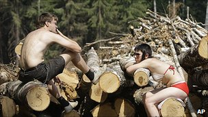 Activists sit on barricades erected to prevent loggers from cutting down a forest in the suburb of Khimki, Moscow, Russia, Monday, July 19, 2010