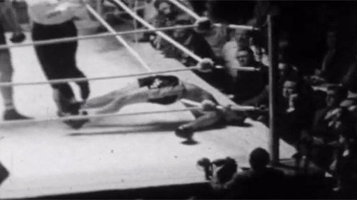 "Joe Erskine is left  - in the memorable words of Harry Carpenter - ""arched like a bow over the bottom rope"" after his knock-out by Henry Cooper"