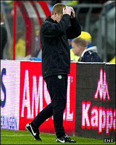 Neil Lennon holds his head in despair