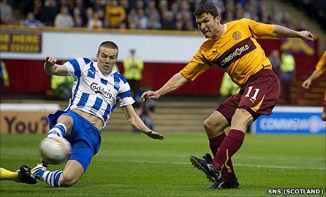 Motherwell striker John Sutton has a shot against Odense