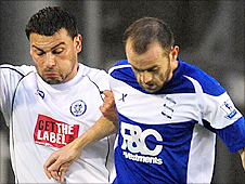 Birmingham's James McFadden (right) is closely watched by Rochdale's Anthony Elding
