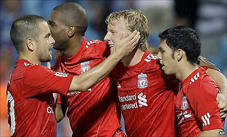 Liverpool striker Dirk Kuyt (second right) is congratulated after scoring against Trabzonspor