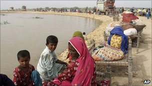 Pakistani villagers whose houses are submerged by floodwater live on an embankment in Thatta near Hyderabad, Pakistan - 26 August 2010