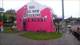 Free Derry Corner being painted pink.