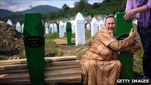 A Bosnian woman cries at the graves of her sons near Srebrenica (July 2010)