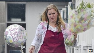 Woman delivers flowers for Samantha Cameron