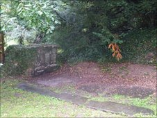 The site of the gravestone, next to remains of the church