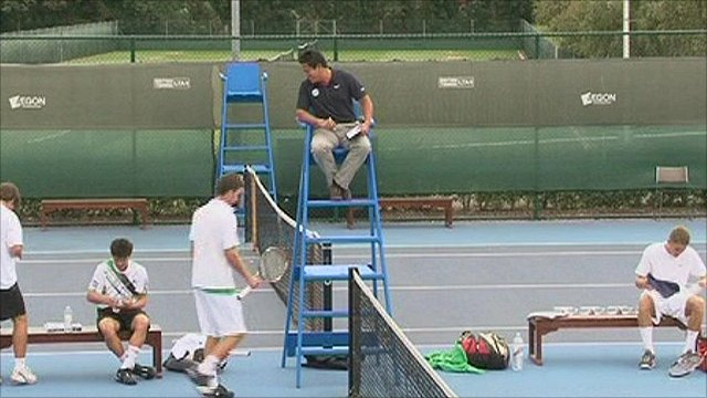 An umpire and tennis players