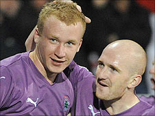 Liam Boyce is congratulated by team-mate Ryan Catney