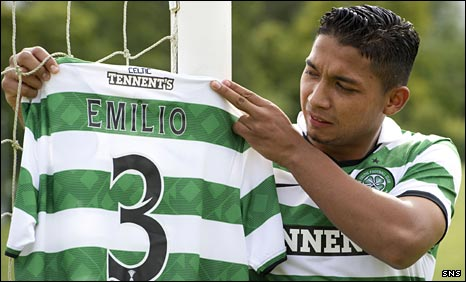 Emilio Izaguirre tries on his Celtic strip for size