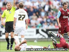 Darren Pratley (on the floor) sees red for his second bookable offence
