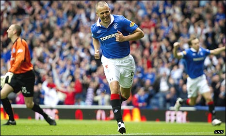 Kenny Miller wheels away in celebration