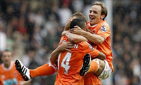 Blackpool's Luke Varney is mobbed by his team-mates after scoring their second goal on Saturday