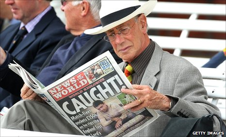 Spectator reads News of the World at Lord's