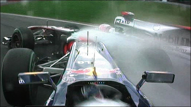Sebastian Vettel crashes into Jenson Button