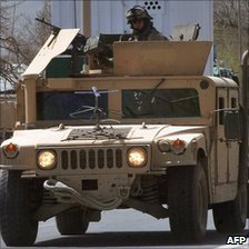 US soldiers riding in an armoured car in Afghanistan