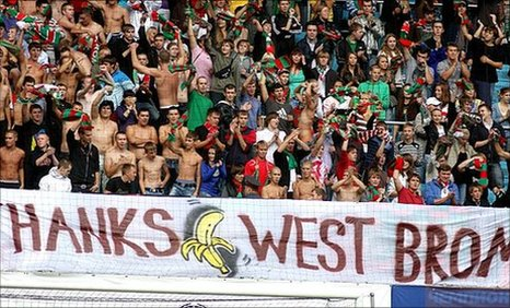 "Lokomotic Moscos fans display a banner showing a banana and the words ""Thanks West Brom"""