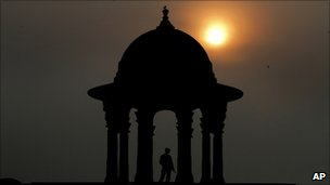 Raisina Hill, which houses important government buildings, as the sun sets in the horizon, in New Delhi, India