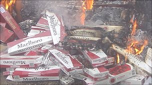 Counterfeit cigarettes being burned