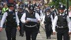 Policing the carnival. Photo: John MacKenzie